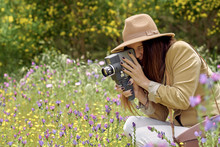 Female Photographer In Hat Wit...