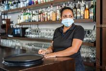 Ethnic Waitress On Protective ...