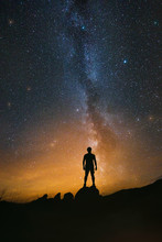 Man Observing The Night Sky Wi...