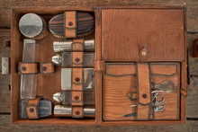 Top View Of Kit Of Various Hairdressing Tools In Box Placed On Wooden Table