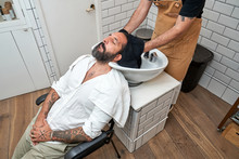 From Above Crop Male Barber Dr...