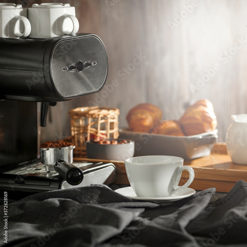 Fotografie, Obraz Coffee on the table in a retro setting on a sunny morning