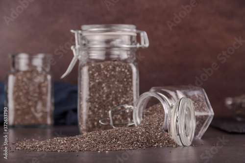 The composition of the glass jars with seeds of chia Poster Mural XXL