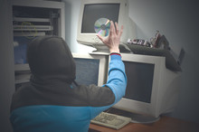 Hacker Holding In Hand An Ille...