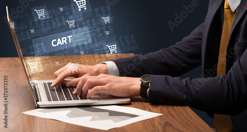 Businessman working on laptop with CART inscription, online shopping concept Slika na platnu