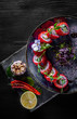 Sushi. Philadelphia roll with fresh salmon, cucumber, avocado, cream cheese, tobiko caviar