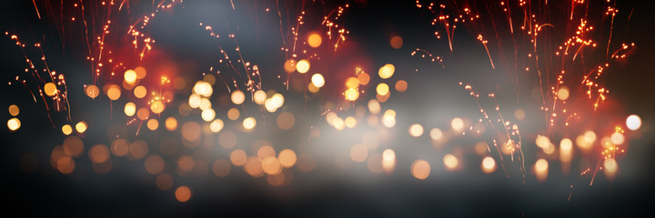 Celebrations with fireworks and bokeh Celebrations with fireworks and bokeh. Horizontal background with blur effects and sparks for silvester and wedding. Special occasion concept with space for text