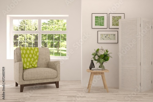 Fotografie, Obraz Idea of white stylish minimalist room with armchair and summer landscape in window