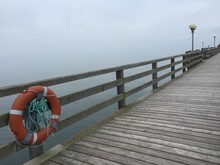 Orange Lifebuoy On Peer At Baltic Sea