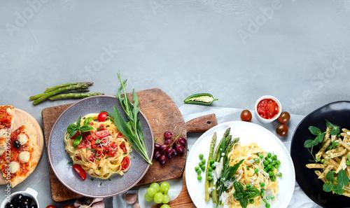 Obraz na plátně Prepared vegan pasta, pizza and snacks