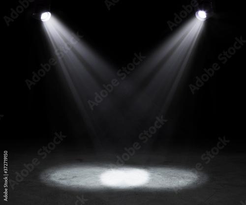Fototapeta 2 stage spotlights on dark background.