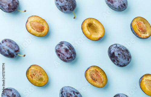 blue plums on turquoise blue background