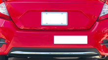 Rear Of Red Car With Blank White License Plate And Bumper Sticker