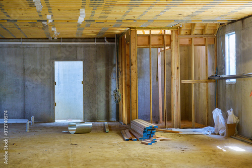 Fototapeta New residential construction home framing with basement view