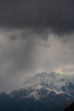 Rain Clouds Over The Snowy Him...