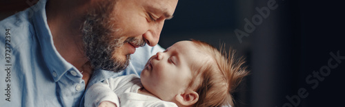Fotografie, Obraz Closeup of middle age bearded Caucasian father with newborn baby
