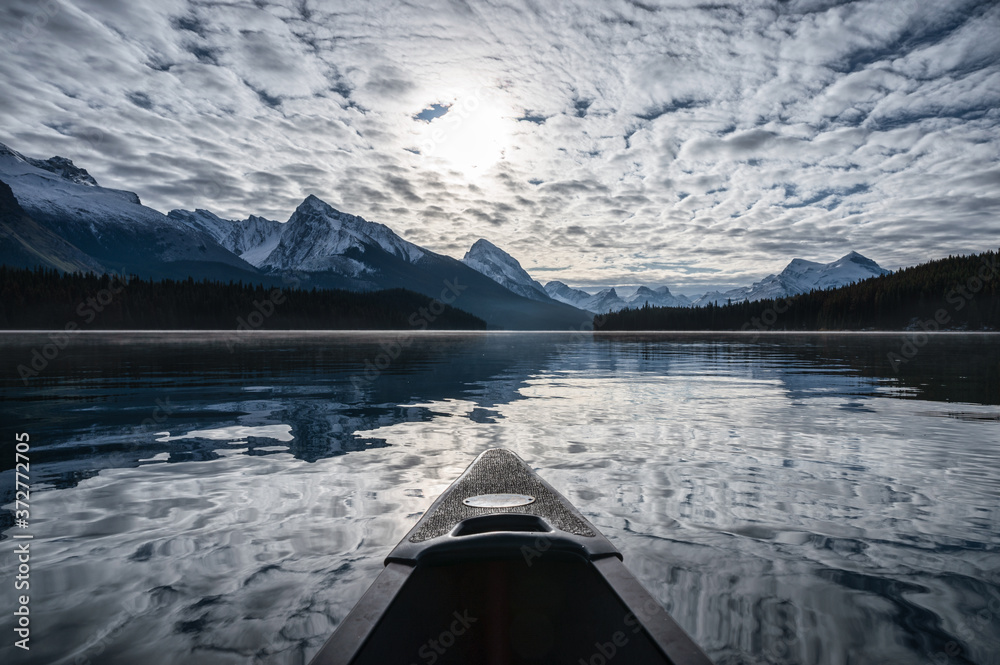 Fototapeta Canoeing into the Spirit Island and altocumulus cloud on Maligne Lake at Jasper national park