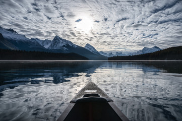 Canoeing into the Spirit Island and altocumulus cloud on Maligne Lake at Jasper national park