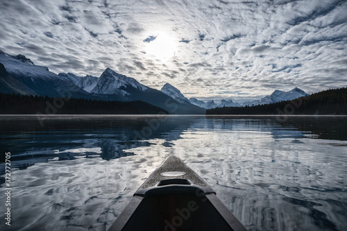 Obraz Canoeing into the Spirit Island and altocumulus cloud on Maligne Lake at Jasper national park - fototapety do salonu