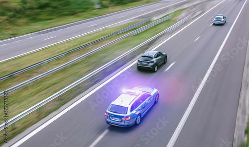 Obraz na plátně German police car on hightway driving fast