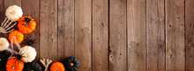 Halloween Corner Border Banner Of Orange, Black And White Pumpkins, Bones And Spiders Against A Rustic Wood Background. Copy Space.