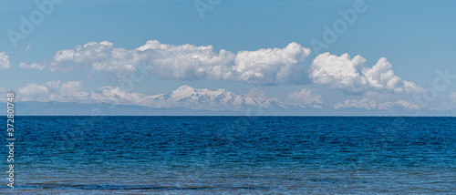 Fotografie, Obraz View Across Lake Titicaca into the Bolivian Andes Mountain Range