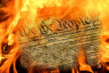 Close Up Of United States Constitution Document Burning In Flames