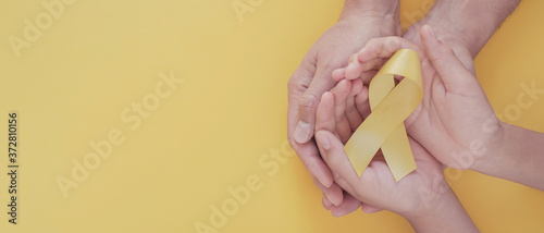 Canvastavla adult and child hands holding yellow gold ribbon, Sarcoma Awareness, Bone cancer