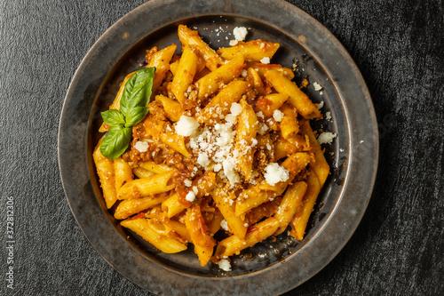 Fototapeta イタリア料理 ペンネ ボロネーゼ  Italian pasta Penne Bolognese