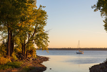 Sailboat At Anchor In A Beautiful Bay Just Before Sunrise In The Fall