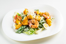 Caesar Salad With Shrimps On The White