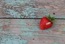 Ripe Strawberries Lie On A Shabby Blue Board