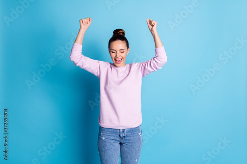 Fényképezés Photo of delighted positive cheerful girl raise fists scream yes celebrate lotte