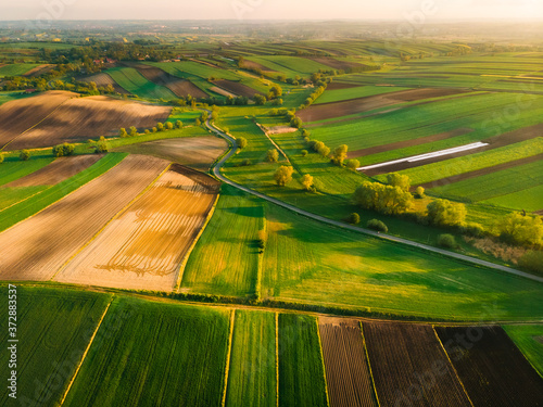 Nida Valley called Ponidzie in spring sunset time, drone aerial photos of fields Fototapet
