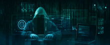 Hooded Hacker Performing An Security Breach