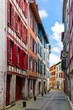 Street with historical houses in Bayonne city center. France