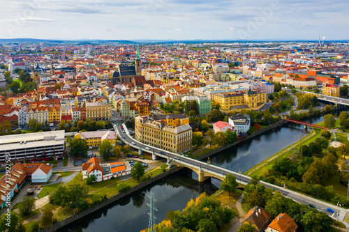 Fotomural Picturesque aerial view of old buildings of Pilsen cityscape with river and pond