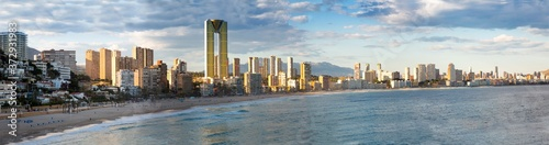 Cuadros en Lienzo sunny sandy beaches of Benidorm with modern housing and mountains on background