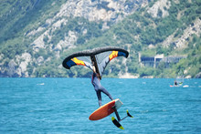 Male Using An Inflatable Wing With A Board On The Lake Garda In Italy