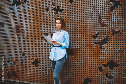 Half length portrait of Caucasian female blogger dressed in casual apparel looki Canvas-taulu