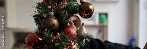 Fototapeta Placing shiny red christmas bauble on holiday tree obraz