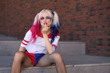 Cosplayer Girl With In Harley Quinn Costume