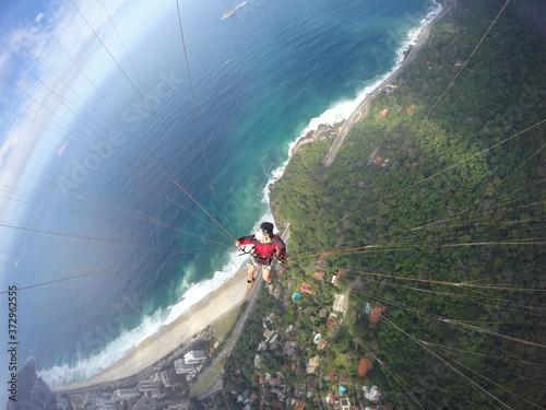 Fotografie, Obraz Paragliding point of view over brazilian beach