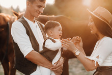 A Family In White Clothes With...