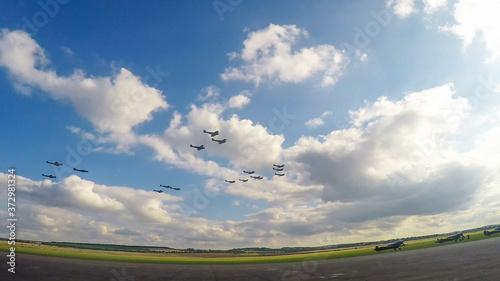 Fotografie, Obraz A flight of World War II era Supermarine Spitfires perform a fly past