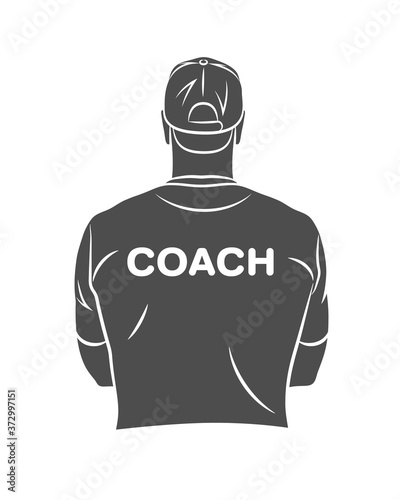 Photo Silhouette sports coach stands with his back in a T-shirt and baseball cap