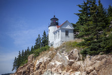 Beautiful Shot Of The Bass Harbor Head Lighthouse In Tremont, USA, Under The Blue Sky