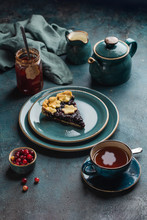 Tea Party At The Autumn Tablewith A Slice Of Berry Pie And A Cup Of Hot Tea. Top View