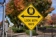 Look Both Ways Warning Sign At A Railroad Junction.