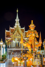 Thai Giant Statue In Front Of Pillar Shrine In Thailand, Nigh Time. They Are Public Domain Or Treasure Of Buddhism, No Restrict In Copy Of Use. Have Thai Language In Picture